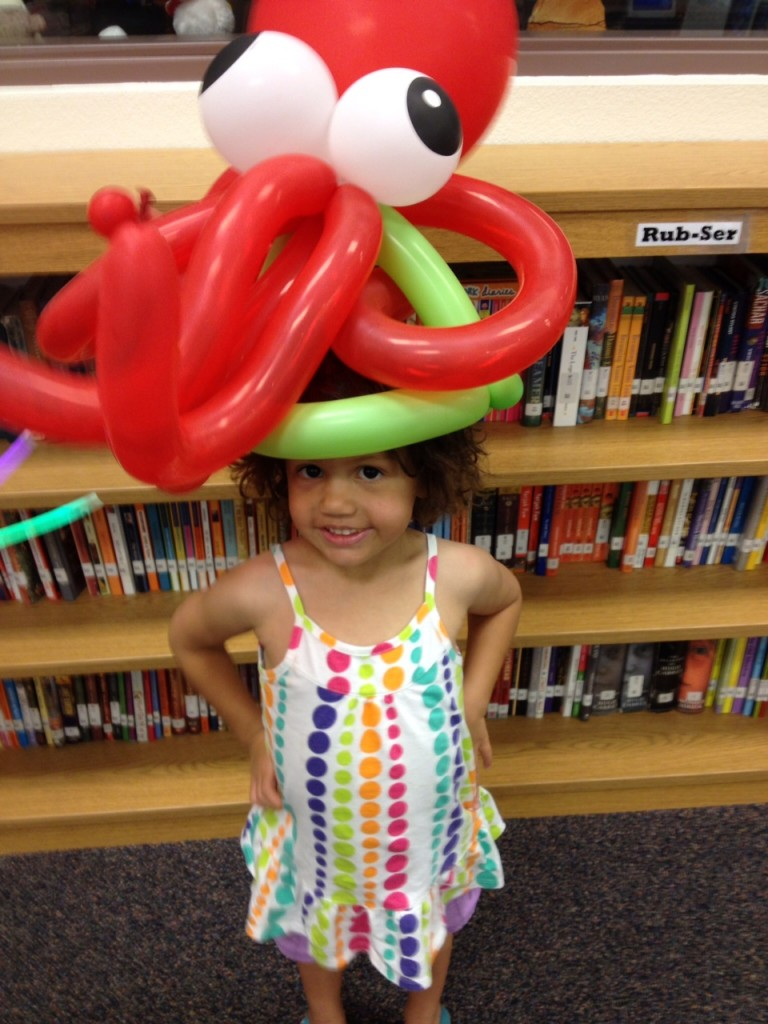 Keira wearing an octopus balloon hat at the library 28 June 2012